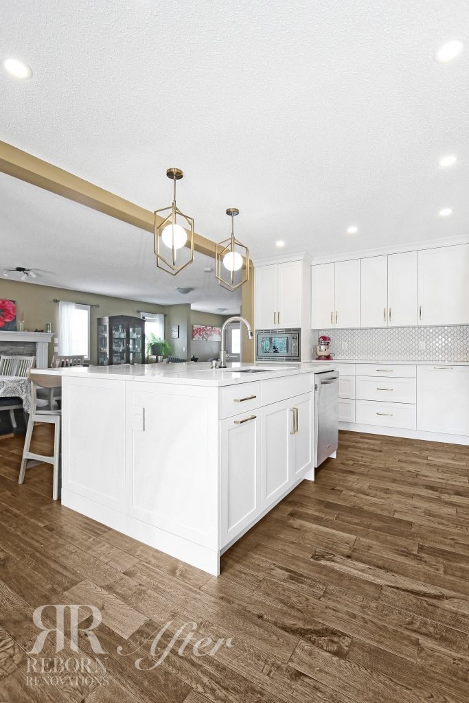 photos of custom kitchen with white color cabinet and countertops, hardwood flooring in Northwest Calgary AB