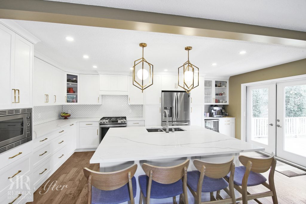 phots of newly built kitchen, custom cabinet, gold cage chandelier, light accent countertops and modern appliances in Calgary AB CA