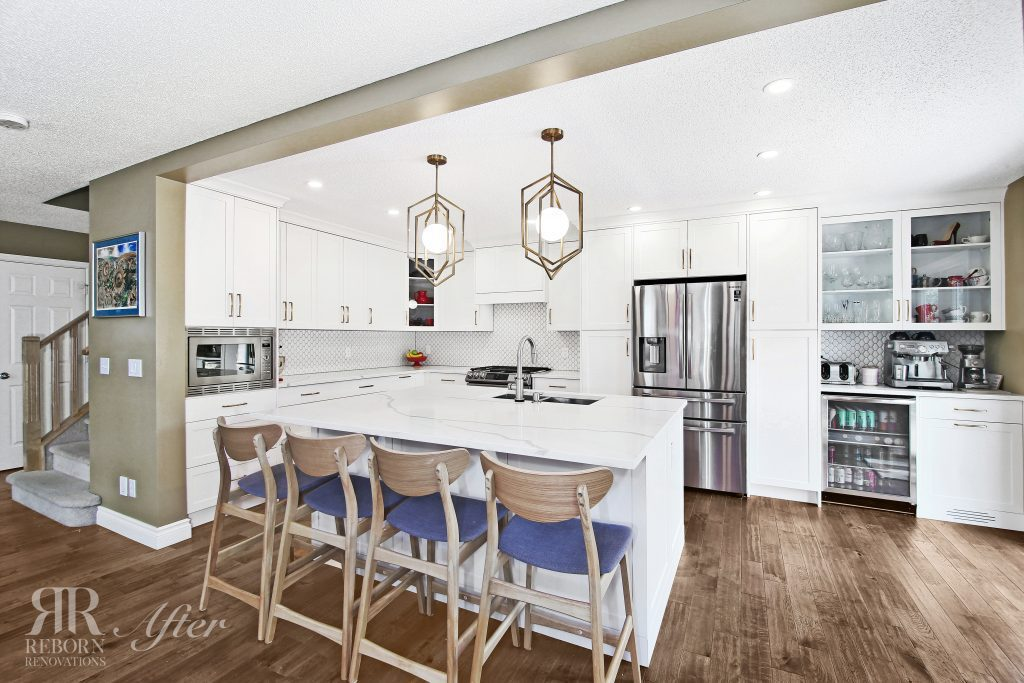 photos of newly renovated kitchen area, wooden flooring, modern appliances, island countertops in Northwest Calgary AB