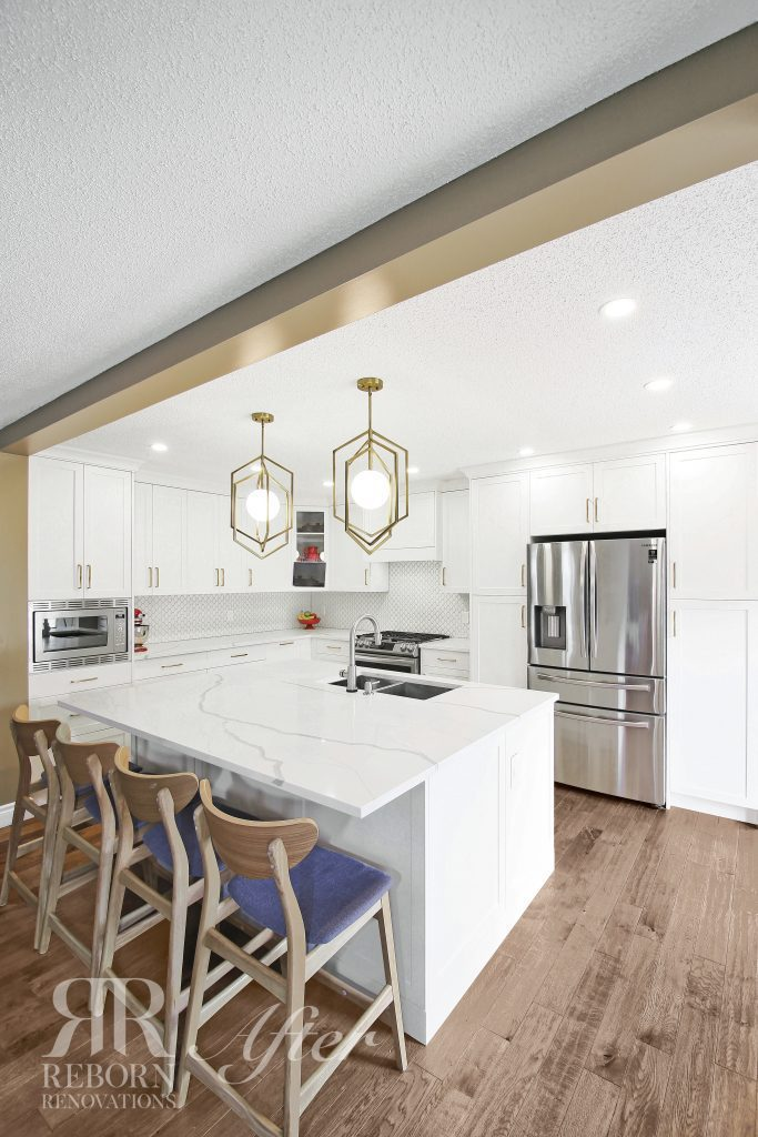 photos of newly renovated kitchen, white cabinetry and countertops with iron cage chandelier, modern appliances in Alberta CA