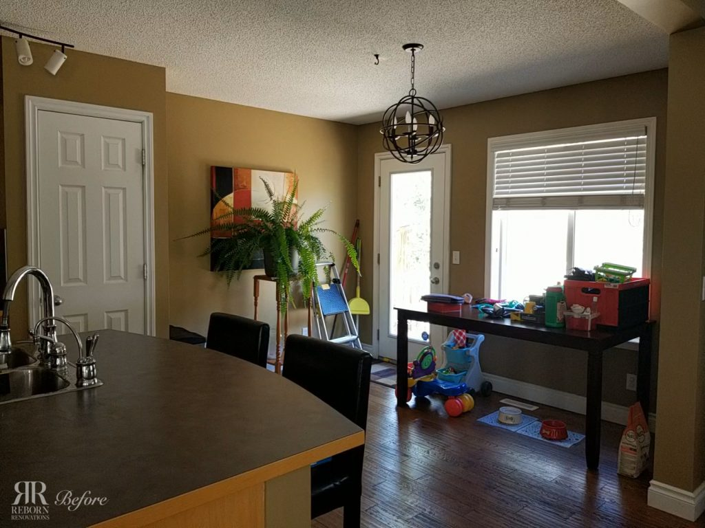 photos of kitchen unrenovated wood laminated countertops, glass kitchen door and window in Calgary AB