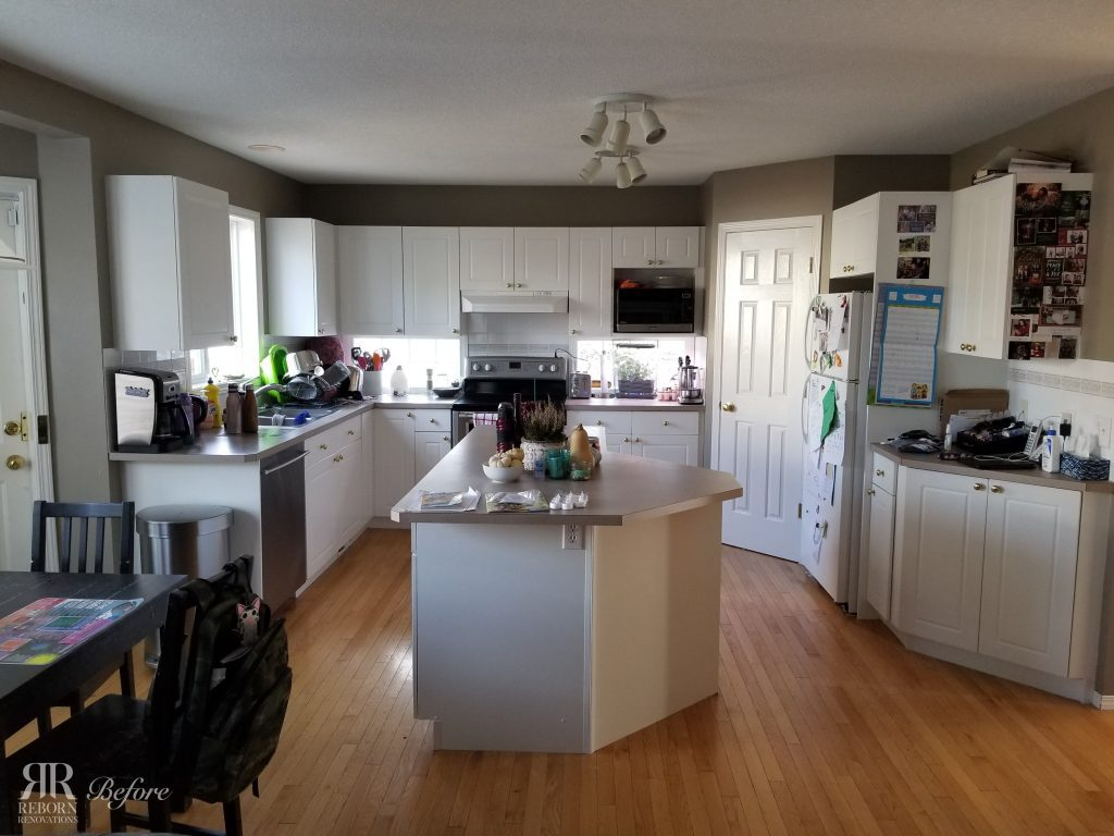 Before Photo of kitchen in Calgary Alberta, before being renovated by Reborn Renovations.