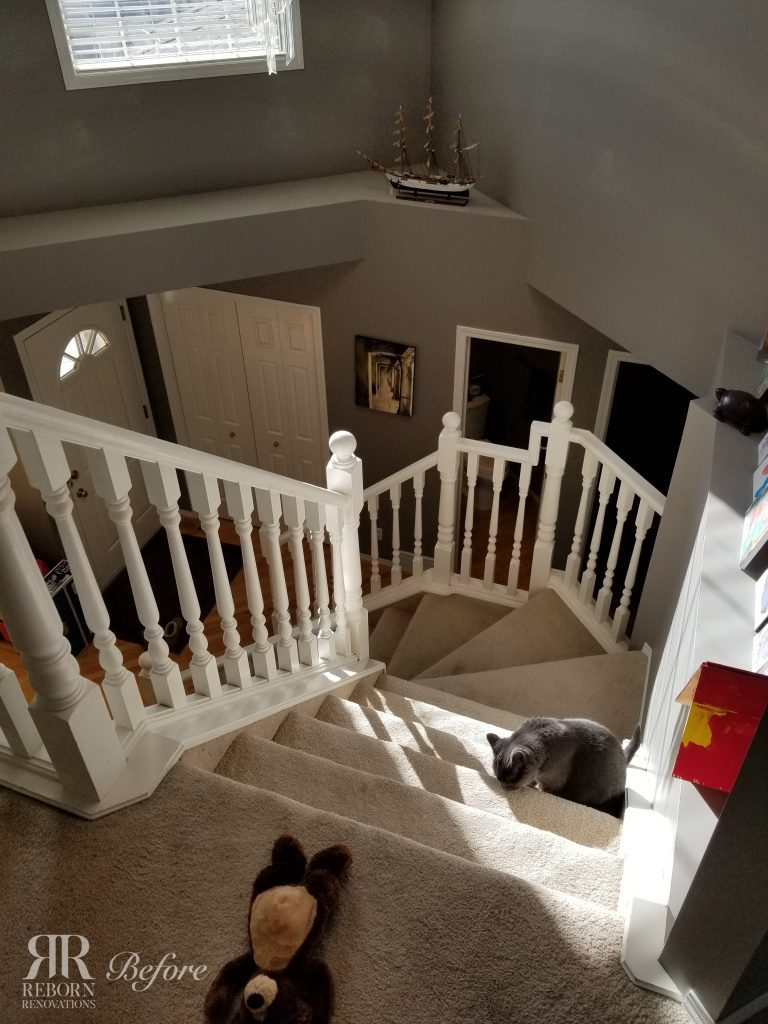 Staircase prior to new flooring, banisters, and handrails