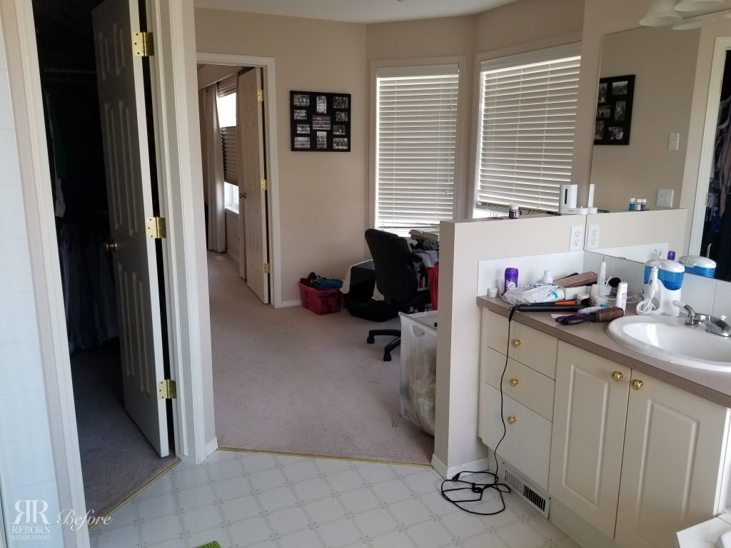 before photo looking from bathroom into walk-in closet and seating powder room area