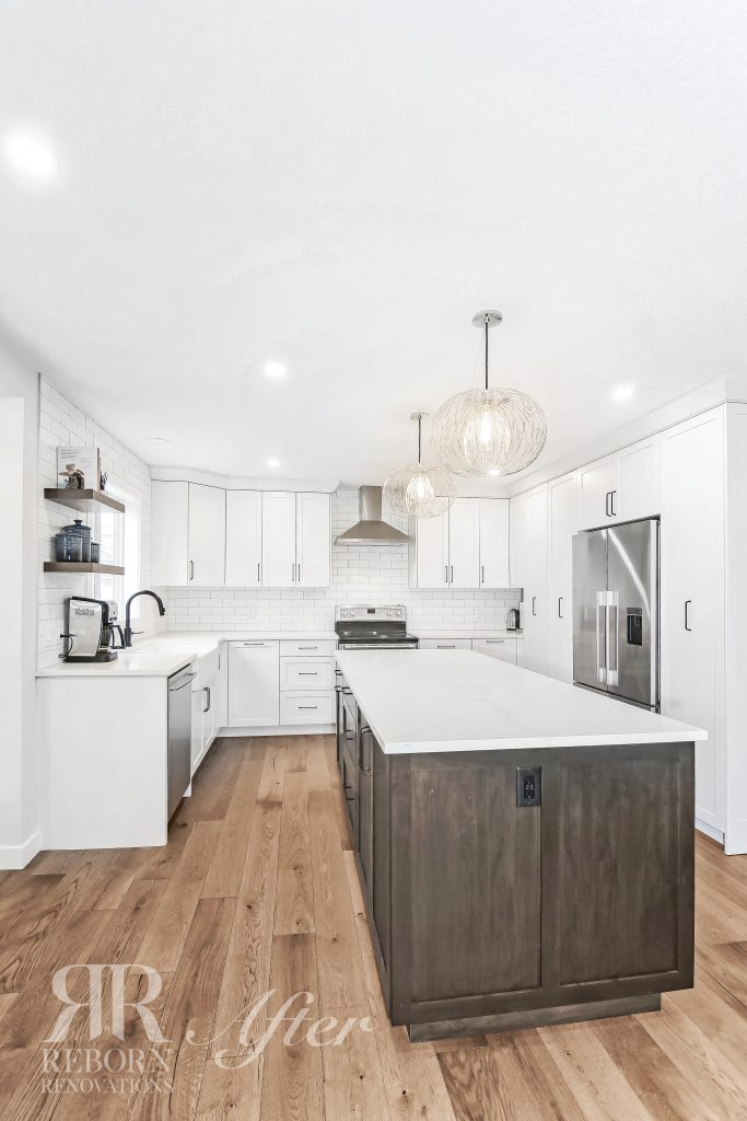 Photo of fully painted modern kitchen, with new cabinetry and countertops, kitchen chandeliers, stainless steel appliances in Strathridge Crescent Southwest, Calgary