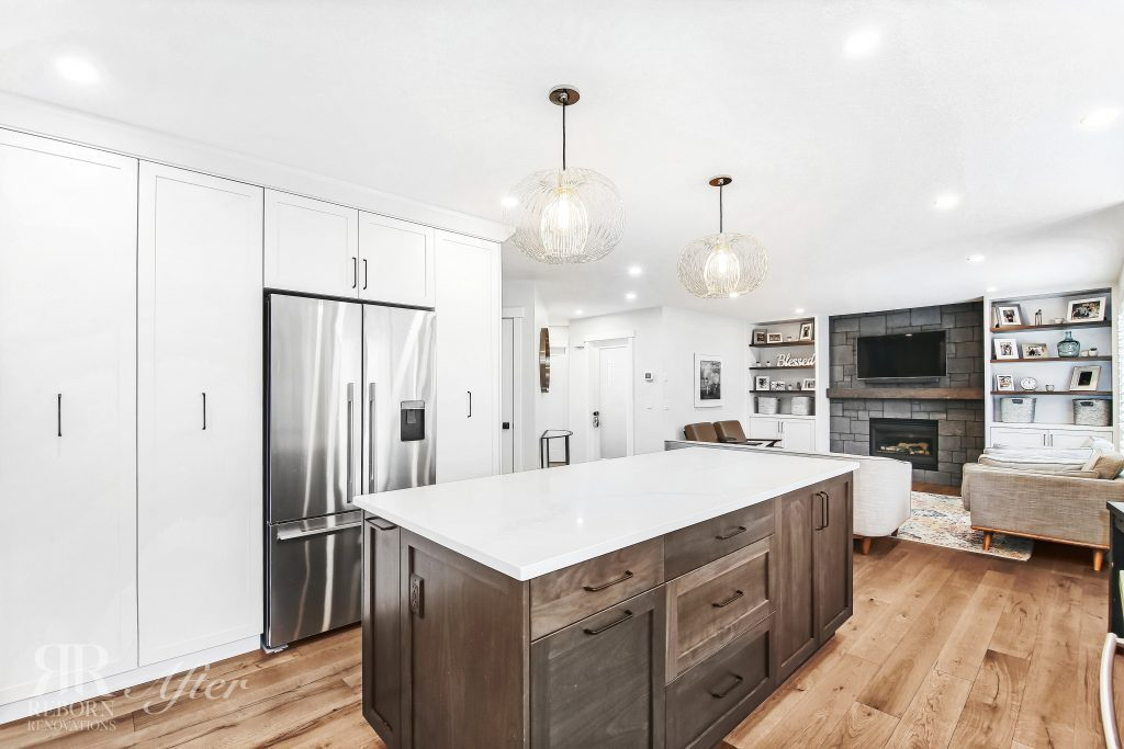 new home design built-in refrigerator in kitchen cabinet, wooden floor, wooden base kitchen with white countertops in Calgary, AB