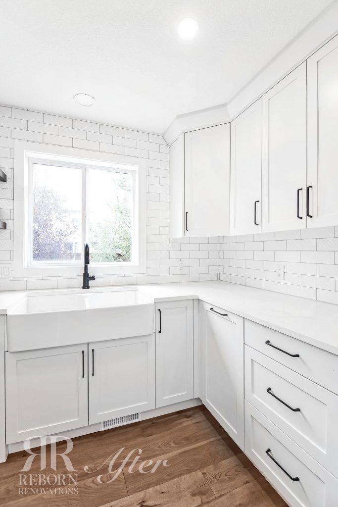 Photos of white painted cabinets, large sink in Strathridge Crescent Southwest, Calgary, AB, Canada