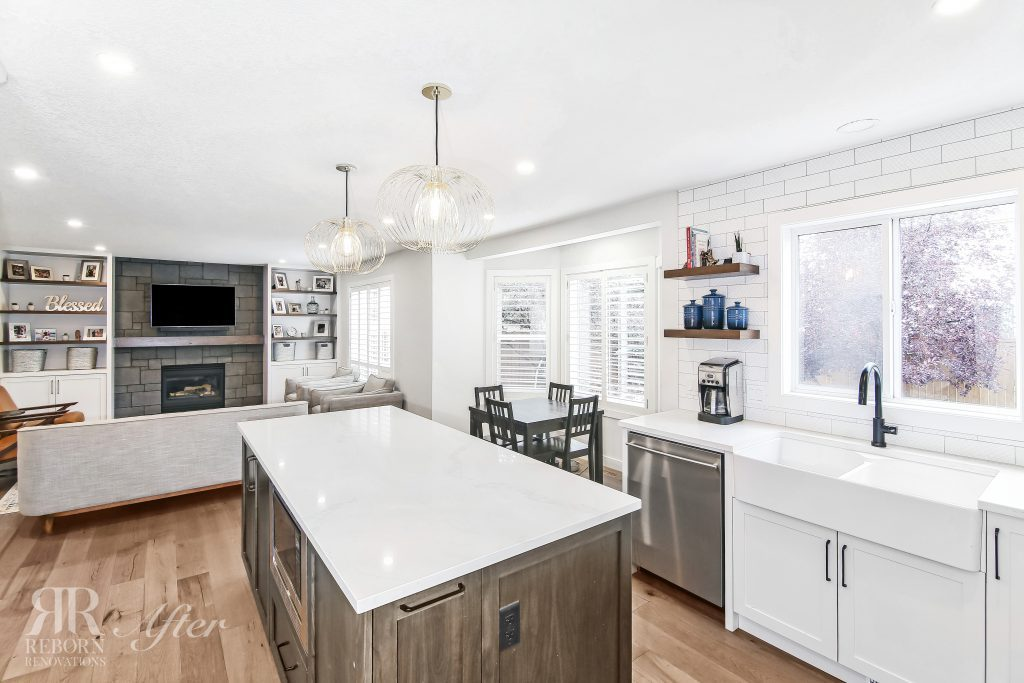 Photo of newly designed kitchen, modern farmhouse style sink and new appliances