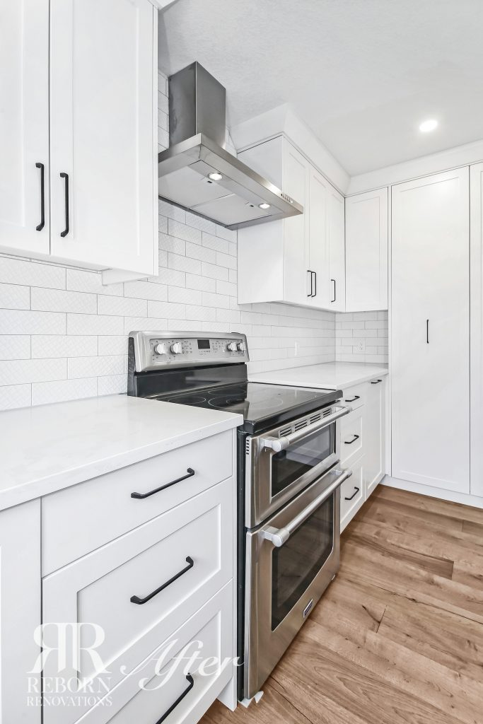 Phots of newly built kitchen cabinets, modern appliances, wooden floor in Calgary Ab