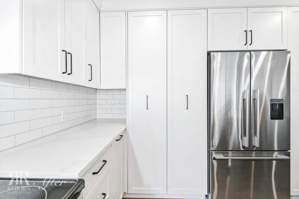 Photos of new, white painted kitchen cabinets, modern kitchen appliances in Soutwest, Calgary, AB, Canada