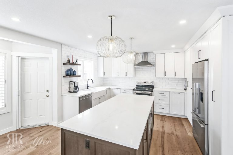 Photos of newly renovated kitchen, wooden flooring, white wooden cabinets with marble countertops, modern design of kitchen cabinets, modern appliances in Calgary AB, CA