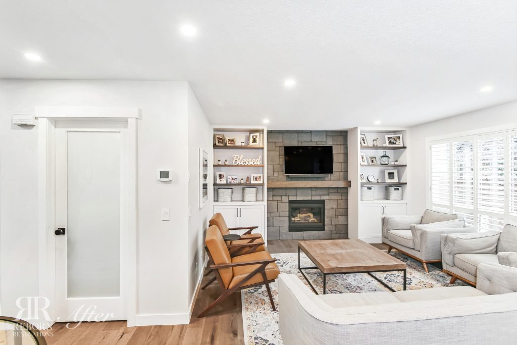 Contemporary home renovation featuring very organized shelving border new fireplace in Strathridge Crescent Southwest, Calgary