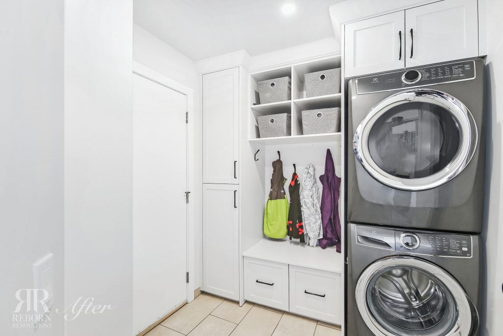 Photos of newly painted laundry room cabinet, modern appliances in Calgary, AB, Canada