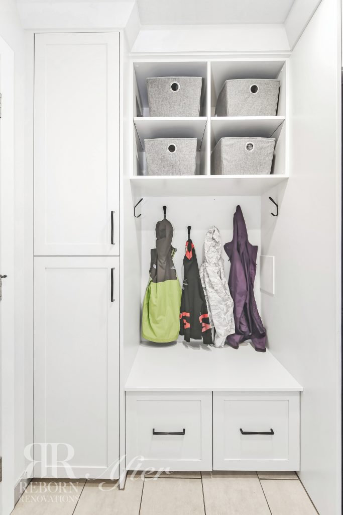Photos of well organized laundry room painted with white shelving in Calgary AB