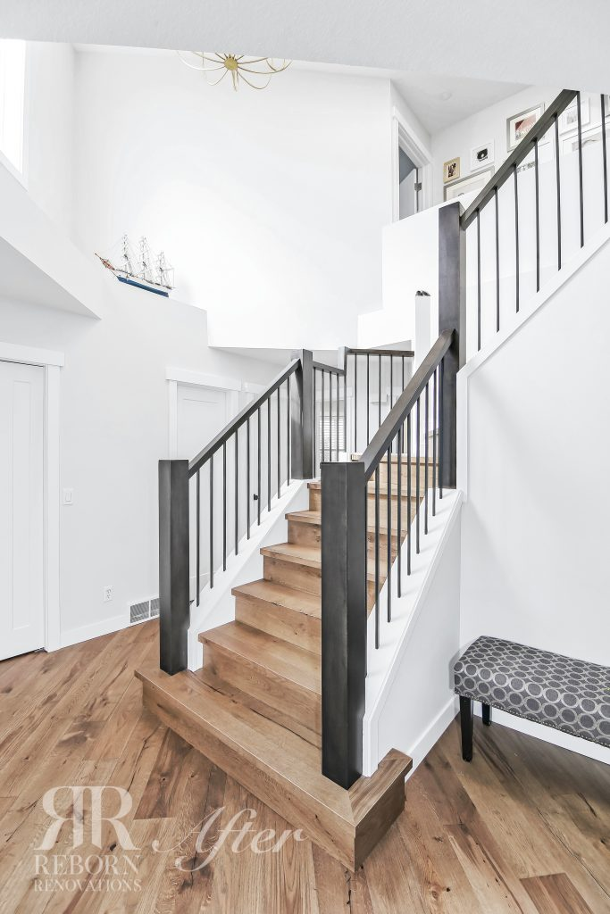 Photo of newly renovated L-shaped stairs going to renovated second floor, hardwood flooring in Stradock Villas Soutwest, Calgary