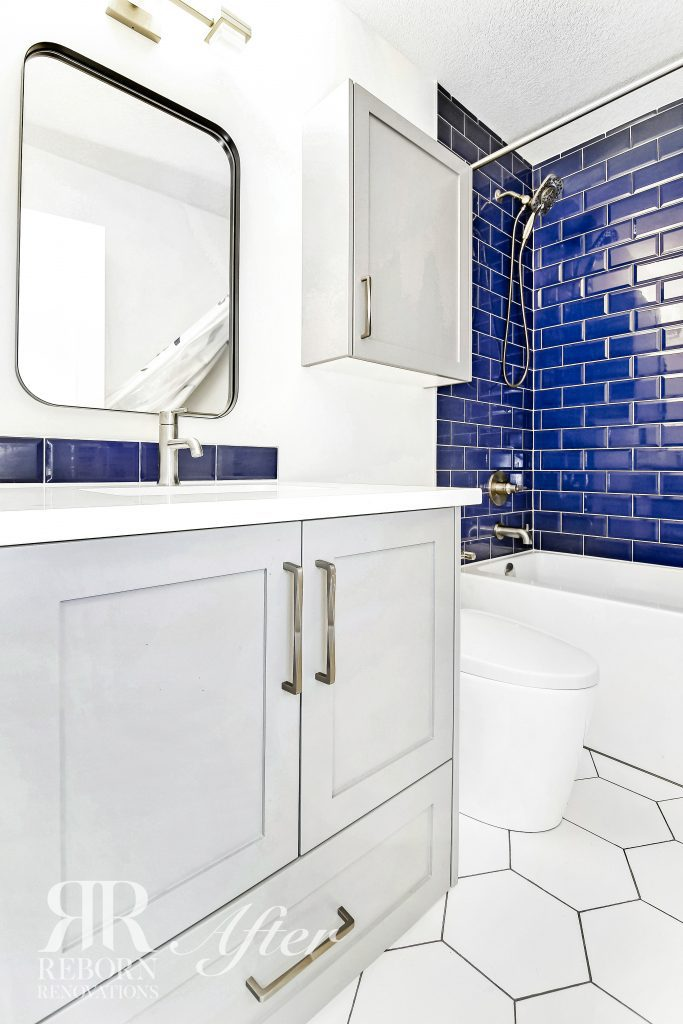 Photos of bathroom renovated, blue color tiles in shower area with bath tub, cabinet base with basin sink in Soutwest, Calgary, AB, Canada