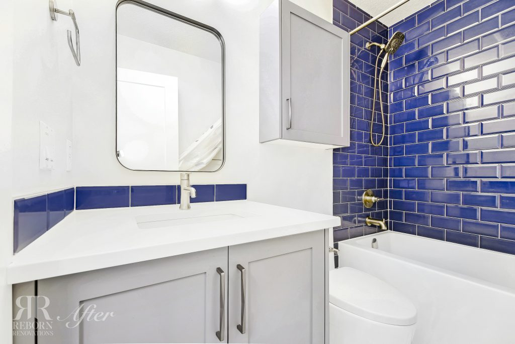 Photos of modern design of bathroom, grey cabinet base with white basin, blue tiled wall for shower and bathroom in Calgary, AB CA