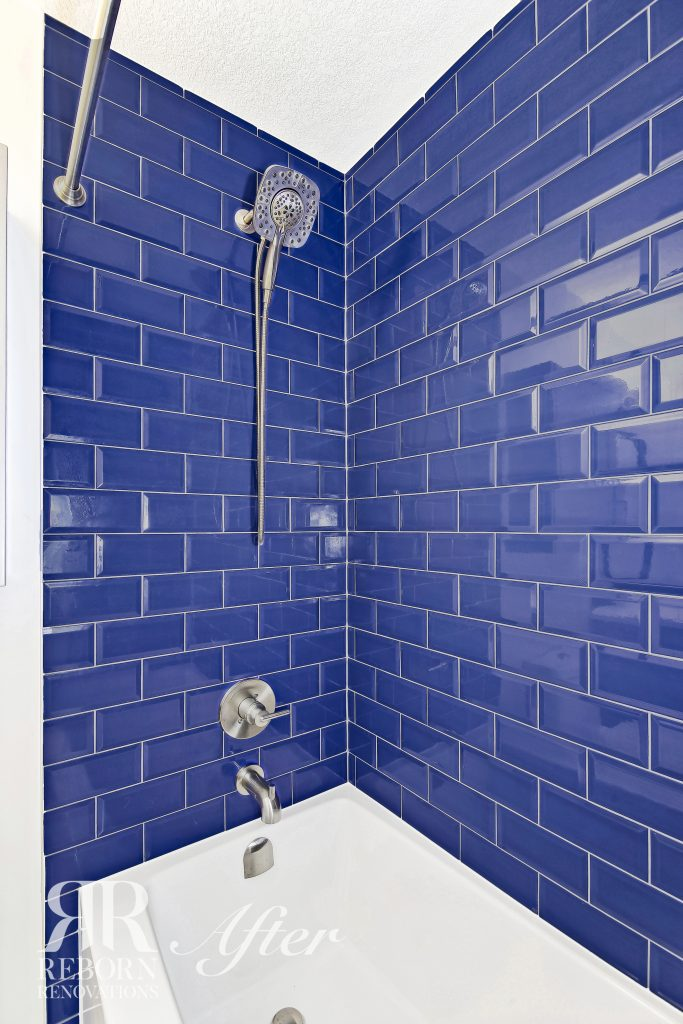 Phots of very artistic blue tiles shower and bath tub in Calgary, AB, Canada