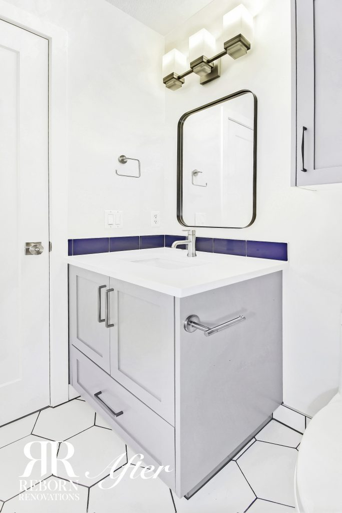 Newly finished bathroom renovation with grey cabinets