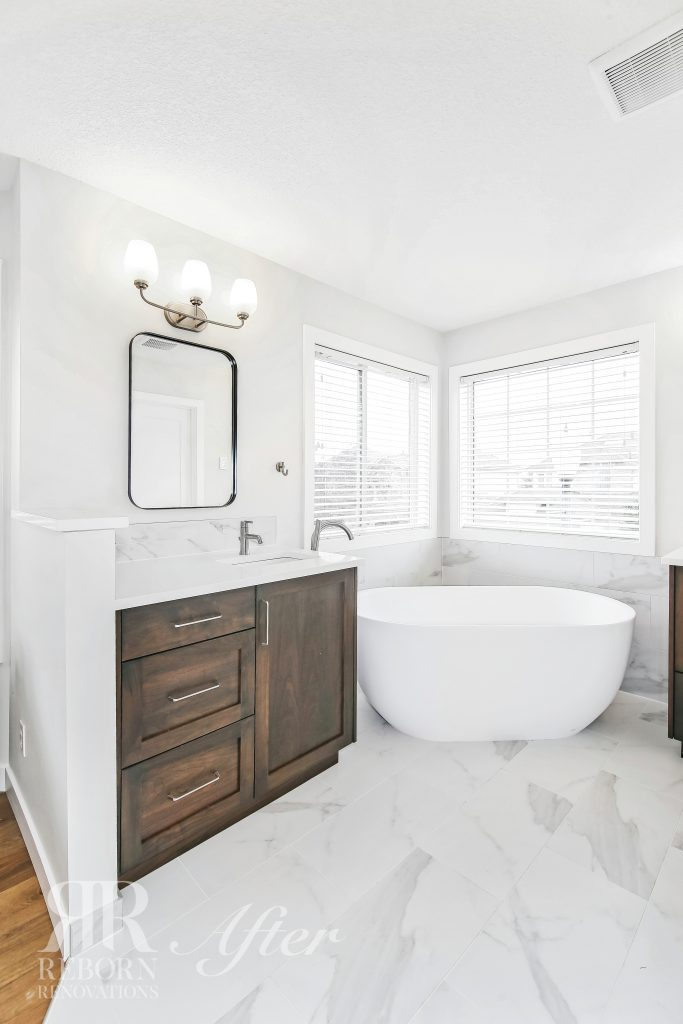 Photos of modern renovated bathroom, brown wooden cabinets with sink, rounded mirror in Strathcona Road Southwest, Calgary, AB, Canada