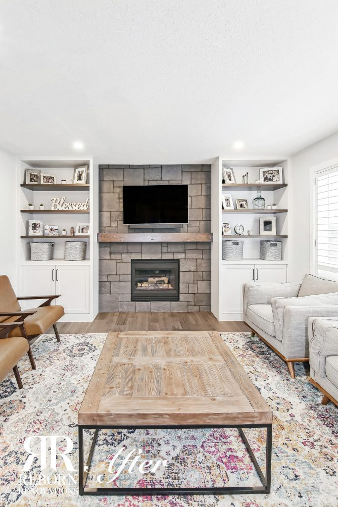 New stone fireplace with white shelving on either side