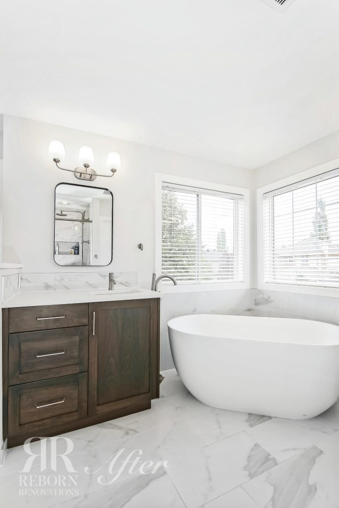 Photos of renovated bathroom, light painted walls and ceilings, wooden base cabinets with sink, classic style bath tub, Strathcona Park Southwest, Calgary, AB, Canada
