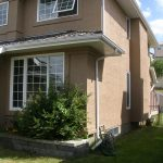 Large Exterior Stucco Wall painted a new colour by legacy exteriors