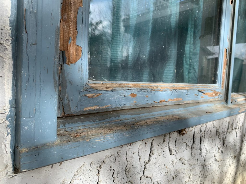 Wooden window frame rotting and falling apart